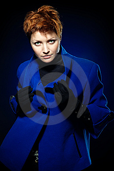 Lady  In A Blue Topcoat Royalty Free Stock Photography - Image: 13747117