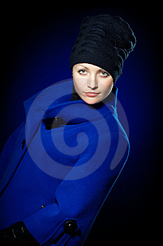 Lady  In A Blue Topcoat Royalty Free Stock Image - Image: 13747136