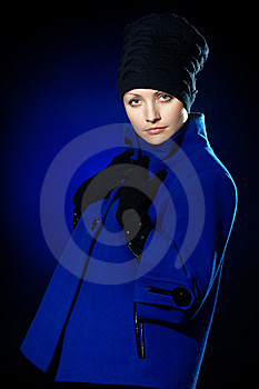 Lady  In A Blue Topcoat Royalty Free Stock Image - Image: 13747146