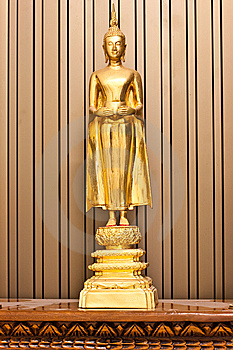 Golden Budha Hold An Alms Bowl Stock Image - Image: 13747841