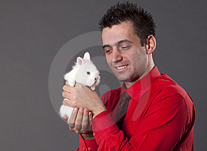 Handsome Young Man Holding White Rabbit Stock Photos - Image: 13750593