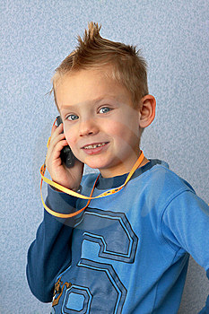 Boy Speaks By Telephone. Stock Photos - Image: 13753863