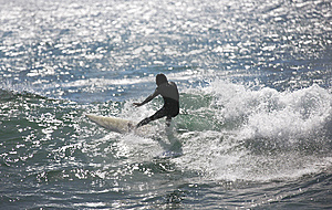 Surfer Rides A Wave Royalty Free Stock Photo - Image: 13755245