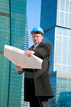 Engineer With Blue Hard Hat Holding Drawing Royalty Free Stock Images - Image: 13758129