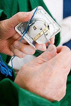 Repairing The Socket Royalty Free Stock Image - Image: 13763436