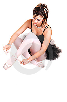 A Young Ballerina Tying Her Ballet Slippers. Stock Image - Image: 13768371