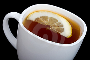Close-up Cup Of Tea With Lemon On Black Royalty Free Stock Photo - Image: 13771315