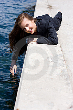 Woman Near The Water Royalty Free Stock Image - Image: 13772246