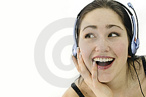 Happy Woman In Headphones Over White. Studio Shot Royalty Free Stock Photo - Image: 13778325