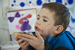 Young Boy Eating A Sandwich. Stock Images - Image: 13783064