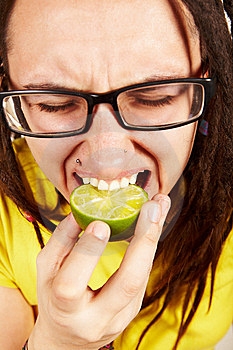 Girl Eating Lime Stock Images - Image: 13788334
