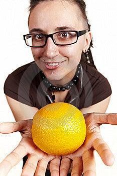 Girl Present An Orange Royalty Free Stock Photos - Image: 13788378