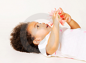 Tender Little Girl With A Flower Royalty Free Stock Images - Image: 13789739