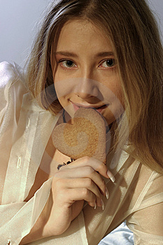 Girl With A Ginger Bread Heart Stock Photo - Image: 1385460