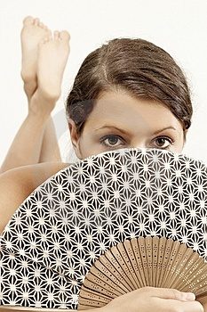 Woman with a fan Stock Photos