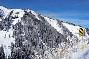 Winter Mountain And Road Sign Stock Image - Image: 1389321