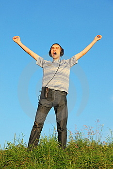 Man Is Standing On A Meadow With Raised Hands Royalty Free Stock Images - Image: 13802929