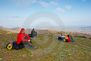 Hikers Sit On The Slope Stock Photo - Image: 13808430