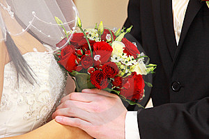 Bride And Groom With Red Rose Bouquet. Royalty Free Stock Image - Image: 13810676