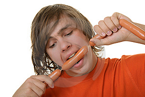Teenager With Appetite Bites Sausages Stock Photography - Image: 13811772