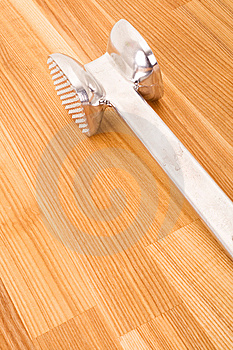 Aluminium Meat Tenderizer On Wooden Background. Royalty Free Stock Photography - Image: 13812987