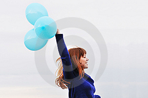 Redheaded Girl Running With Balloons Royalty Free Stock Images - Image: 13814039