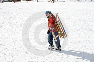 Young Boy Carries The Sledge Royalty Free Stock Photo - Image: 13815275