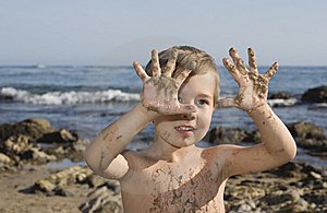 Boy At The Beach Playing With Sand Stock Photos - Image: 13823253