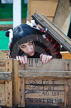 The Girl Gets Out Of The Shipping Container Royalty Free Stock Image - Image: 13823296