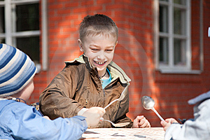 Boys With Three Spoons In The Garden Royalty Free Stock Images - Image: 13830429