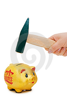 Hand With Hammer And Piggy Bank Stock Photo - Image: 13831090