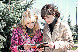 Two Girls Read The Book In A Park Royalty Free Stock Photo - Image: 13833435