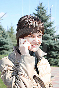 Young Girls Call By Phone In A Park Stock Photography - Image: 13833662