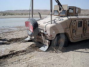 US Army Humvee Stuck In Sand Stock Photography - Image: 13836382