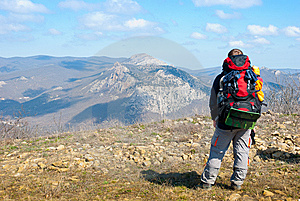 Hiker On A Peak Royalty Free Stock Photo - Image: 13836785