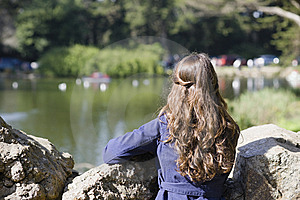 Woman Looking At Pond Stock Photo - Image: 13838110