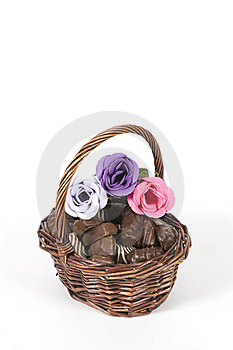 Dark Brown Basket Filled With Chocolate And Roses Stock Photo - Image: 13845160