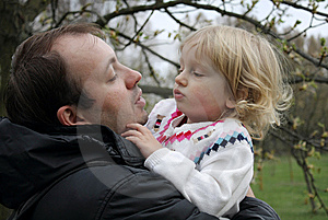 Dad Keeps Daughter In Her Arms Stock Photo - Image: 13850350