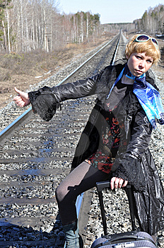 Woman With The Luggage On The Rails Stock Photo - Image: 13851710