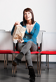 Surprised Young Woman Sitting And Looking Up Stock Photos - Image: 13860473