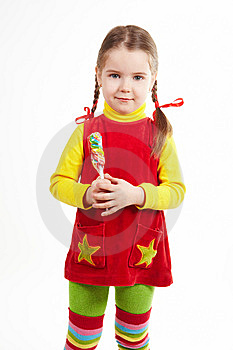 Girl Stand With Candy 2 Royalty Free Stock Photo - Image: 13861435