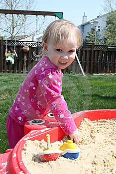 Little Blonde Baby In Sandbox Royalty Free Stock Photography - Image: 13865307