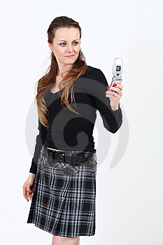 The Attractive Woman With A Mobile Phone Royalty Free Stock Photo - Image: 13866225
