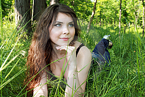 Pretty Woman Lay In Green Grass Royalty Free Stock Images - Image: 13868789
