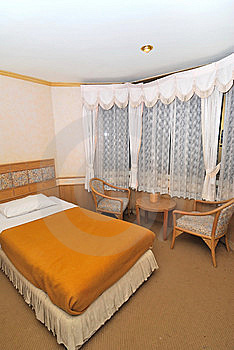 Single Bed In Hotel Room With Furniture Stock Photography - Image: 13876942