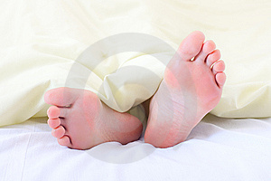 Feet Under Blanket Stock Photos - Image: 13877443