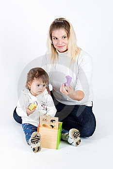 Mother And  Daughter Playing With Puzzle Cube Royalty Free Stock Photography - Image: 13889987