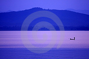The Fisherman In Kraseaw Dam,Thailand Royalty Free Stock Photography - Image: 13890837