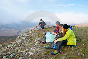 Hikers Sit On The Peak Stock Image - Image: 13893431