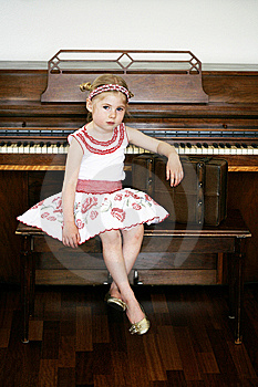 Little Girl Next To A Piano Royalty Free Stock Image - Image: 13893616